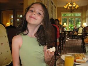 Laurel, eating a bagel.